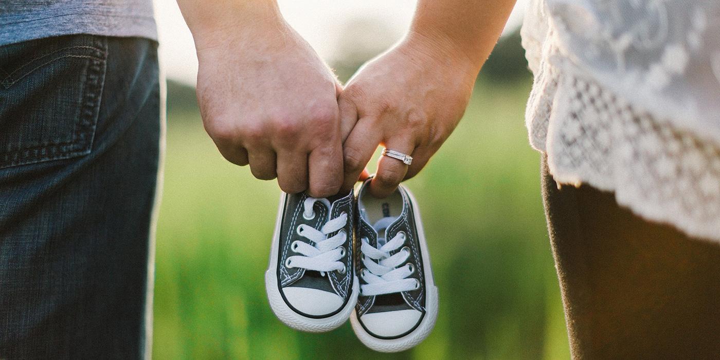 holding hands baby newborn